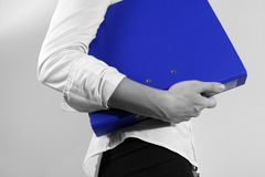Businesswoman Holding a Binder. In blue stock photos