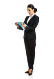 Businesswoman holding a binder. Beautiful businesswoman holding a binder Royalty Free Stock Image