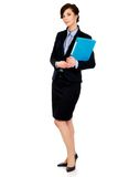 Businesswoman holding a binder. Beautiful businesswoman holding a binder Royalty Free Stock Photography