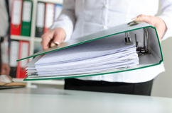 Businesswoman holding a binder. At office Stock Photo