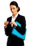 Businesswoman holding a binder and pen Stock Photo