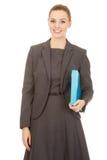 Businesswoman holding a binder. Stock Photo