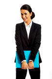 Businesswoman holding a binder. Smiling businesswoman holding a binder Royalty Free Stock Images