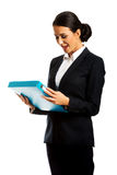 Businesswoman holding a binder. Smiling businesswoman holding a binder Stock Photography