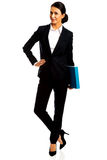 Businesswoman holding a binder. Smiling businesswoman holding a binder Royalty Free Stock Photography