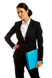 Businesswoman holding a binder. Smiling businesswoman holding a binder Royalty Free Stock Photo