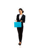 Businesswoman holding a binder. Smiling businesswoman holding a binder Stock Image