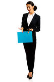 Businesswoman holding a binder. Smiling businesswoman holding a binder Stock Photos
