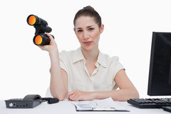 Businesswoman holding binoculars Royalty Free Stock Photo