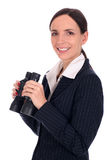 Businesswoman holding binoculars Stock Images