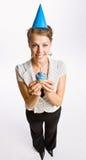 Businesswoman holding birthday cupcake Stock Image