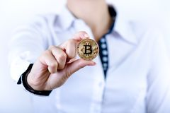 Businesswoman holding bitcoin isolated on a white background.Golden bitcoin coins in women`s hands. Virtual currency. Royalty Free Stock Photo