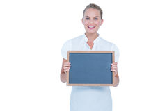 Businesswoman holding a black board Royalty Free Stock Image