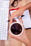 Businesswoman holding black coffee cup Royalty Free Stock Photo
