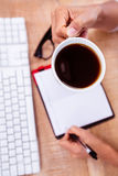 Businesswoman holding black coffee cup Stock Photo