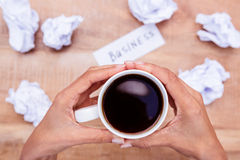 Businesswoman holding black coffee cup Stock Image
