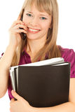Businesswoman holding a black folder. Businesswoman calling by phone and smiling Royalty Free Stock Photo