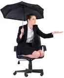 Businesswoman holding a black umbrella Stock Photography