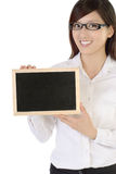 Businesswoman holding blackboard Royalty Free Stock Images