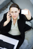 Businesswoman holding a blank  Stock Images
