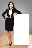 Businesswoman holding blank billboard Royalty Free Stock Photo