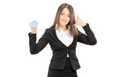 Businesswoman holding a blank blue card Stock Photos