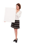 Businesswoman holding blank board royalty free stock photography