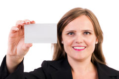 Businesswoman holding a blank business card. Smiling business woman holding a blank business card over white background Royalty Free Stock Image