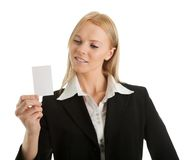 Businesswoman holding blank card Royalty Free Stock Photos