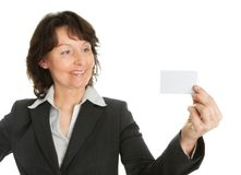 Businesswoman holding blank card Stock Photos