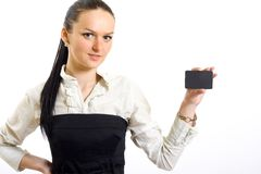 Businesswoman holding a blank card. Closeup of a business woman holding a blank businesscard Royalty Free Stock Photo