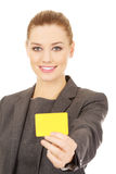 Businesswoman holding blank card. Royalty Free Stock Photos