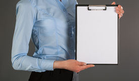 Businesswoman holding blank clipboard Royalty Free Stock Image