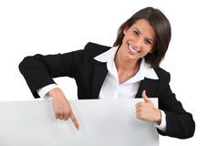Businesswoman holding blank message board Stock Photo