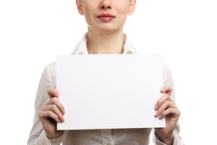 Businesswoman holding a blank page. Beautiful businesswoman in a white shirt holding a blank page. Isolated on white background Stock Photography