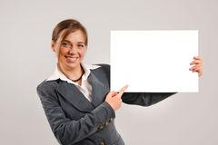 Businesswoman holding a blank page Royalty Free Stock Images