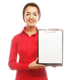 Businesswoman holding blank paper on clipboard Royalty Free Stock Image