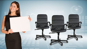 Businesswoman holding blank paper sheet. Office Royalty Free Stock Image