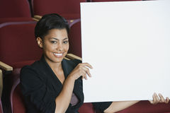 Businesswoman Holding Blank Placard Royalty Free Stock Photo