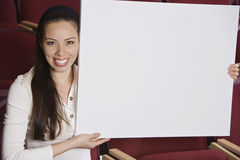 Businesswoman Holding Blank Placard Stock Photo