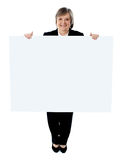 Businesswoman holding a blank poster Stock Photography