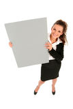 Businesswoman holding blank poster Royalty Free Stock Image