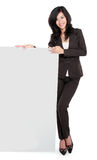 Businesswoman holding a blank presentation board Royalty Free Stock Photo