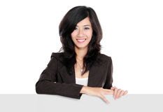 Businesswoman holding a blank presentation board Stock Photo