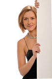 Businesswoman holding a blank sign Stock Photo