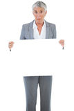 Businesswoman holding blank sign Stock Photography