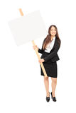 Businesswoman holding a blank signboard Stock Image