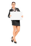 Businesswoman holding a blank signboard Stock Images