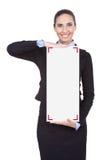 Businesswoman holding blank sing Stock Photos