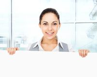 Businesswoman holding a blank white card board Stock Images